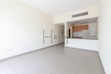 Studio for Rent in Dubai Residence Complex, Dubai - Chiller Free unit with Balcony near Skycourt