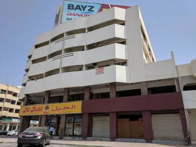 Shop for Rent in Al Karama, Dubai - Showroom Available for Lease in Al Karama Building