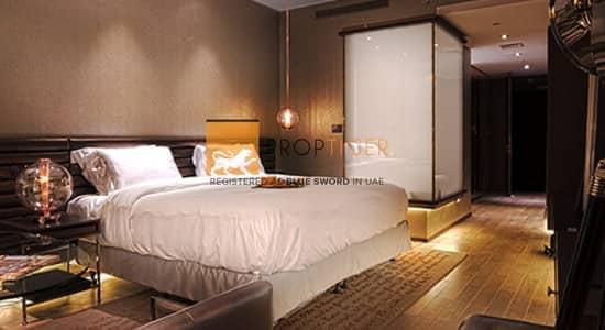 شقة فندقية 1 غرفة نوم للبيع في الخليج التجاري، دبي - Hollywood-inspired hotel rooms in the Burj area free of 5% VAT and 4% DLD fees