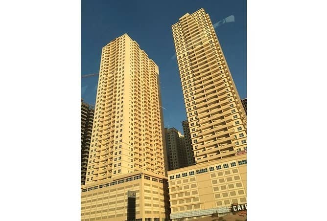 DEAL OF THE DAY  SPACOIUS 1 BHK WITH PARKING 18000 ONLY IN LILIES TOWER ,EMIRATES CITY AJMAN .