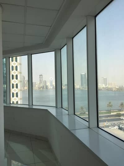 Office for Rent in Al Majaz, Sharjah - LAVISH FULL SEE VIEW OFFICE IN MAJAZ-3 FOR ONLY 50K
