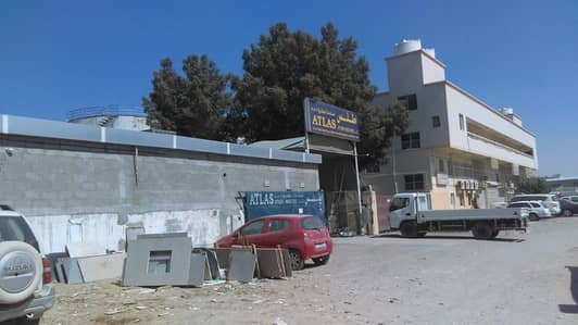 Plot for Rent in New Industrial City, Ajman - Amazing commercial plot for rent with offices.