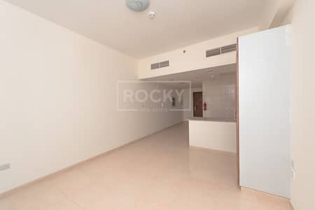 Studio for Rent in Dubai Residence Complex, Dubai - Studio Apartment with Fixed Chiller in Ajmal Sarah