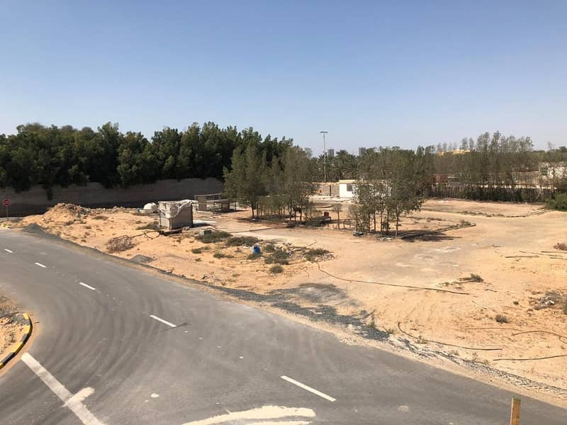 commercial land in al yasmeen area first plot on al zubai main road ground and two floors freehold