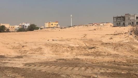 Plot for Sale in Al Helio, Ajman - Own a piece of land in the Yasmine district located behind the Jasmine Park in a period of unpaid i