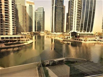 شقة 2 غرفة نوم للايجار في أبراج بحيرات جميرا، دبي - شقة في برج ماج 214 أبراج بحيرات جميرا 2 غرف 85000 درهم - 4017472