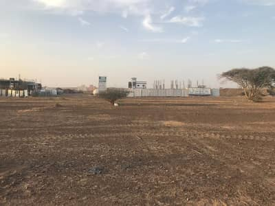 Plot for Sale in Al Manama, Ajman - commercial land on main road only 280k without fees to all nationalities