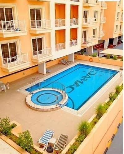 Studio for Rent in Jumeirah Village Circle (JVC), Dubai - 32K BY 4 CHEQUES FOR LARGE STUDIO IN EMIRATES GARDENS 1
