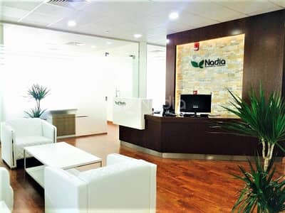 Office for Rent in Sheikh Zayed Road, Dubai - Furnished Office with Glass Partitions|Sheikh Zayed Road