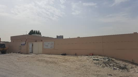 Industrial Land for Rent in Industrial Area, Sharjah - FENCED LAND AT INDUSTRIAL AREAS 12, SHARJAH FOR RENT
