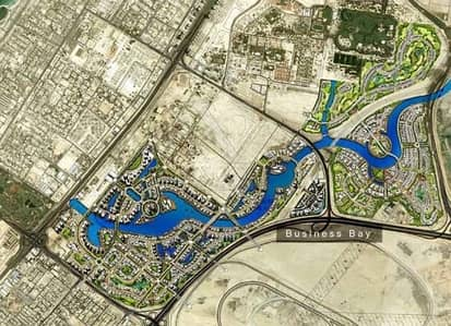 ارض استخدام متعدد  للبيع في الخليج التجاري، دبي - Plot with full lake view in prime location of Business Bay