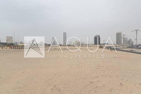 ارض سكنية  للبيع في مدينة دبي الرياضية، دبي - Huge corner plot on Shk Mohd Bin Zayed Rd