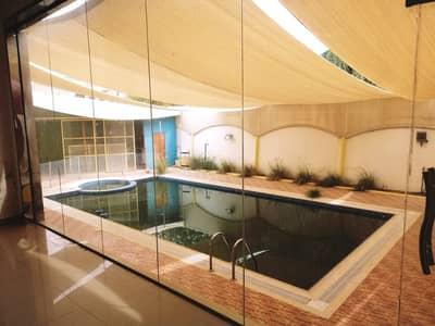 فیلا 5 غرفة نوم للايجار في الروضة، عجمان - فیلا في الروضة 2 الروضة 5 غرف 88000 درهم - 4105515