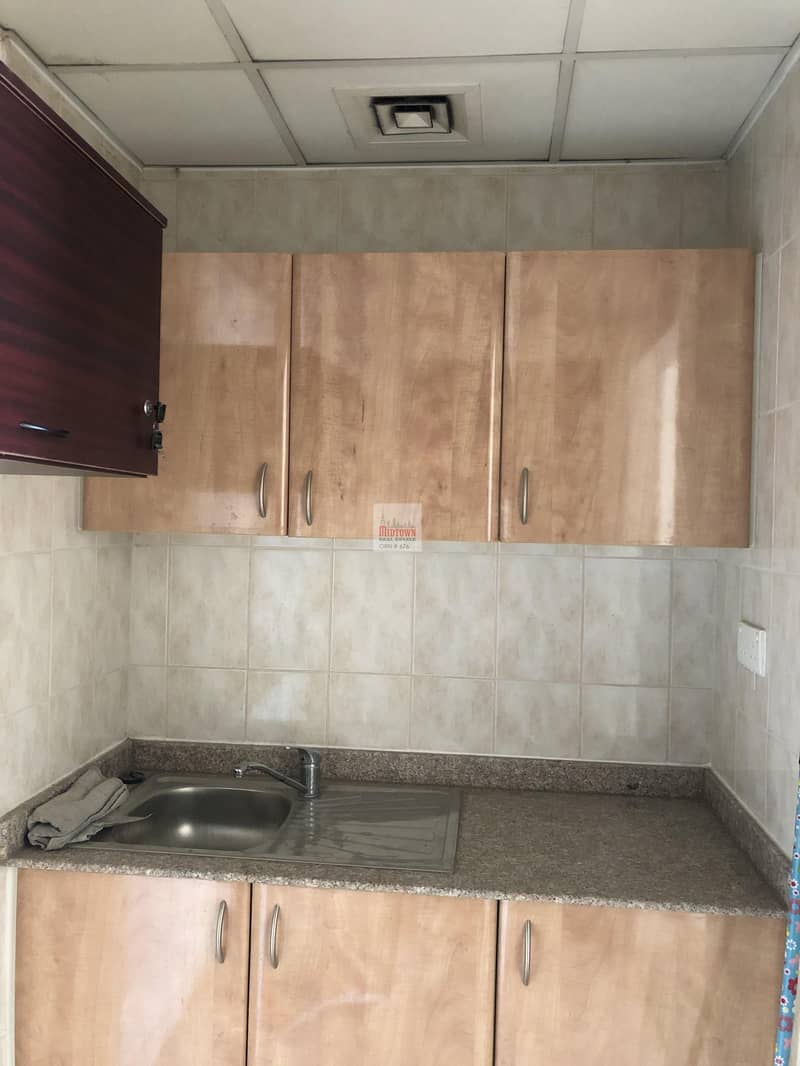 2 Fully fitted small shop available for rent in international city just for AED 24k