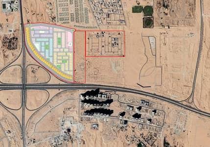 ارض تجارية  للبيع في المنامة ، عجمان - أرض للبيع بالمنامة تملك حر للوافدين _____ مخطط تجاري جديد
