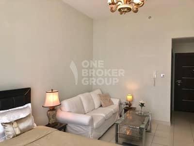 Studio for Rent in Dubai Studio City, Dubai - High Floor / Fully Furnished/ Large Balcony