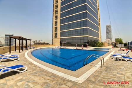 2 Bedroom Apartment for Sale in Jumeirah Village Circle (JVC), Dubai - Panoramic View on Golf Course and Pool | 2 Bedrooms with Maids Room | Special Offer for You!