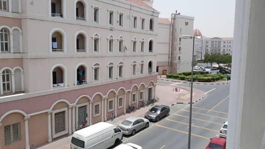 شقة في طراز إيطاليا المدينة العالمية 1 غرف 33000 درهم - 4159226