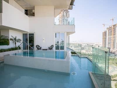 شقة 2 غرفة نوم للبيع في دائرة قرية جميرا JVC، دبي - EXCLUSIVE l FIVE Star 2 Bed With Terrace and Pool