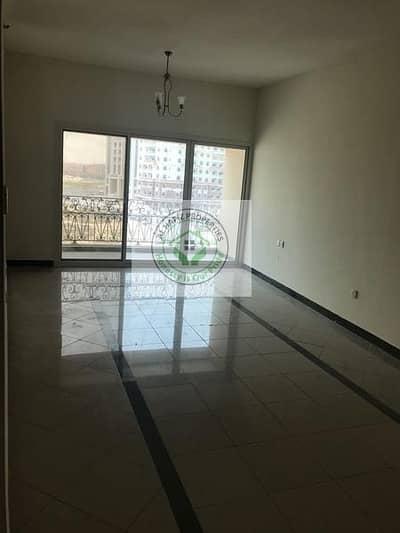 فلیٹ 1 غرفة نوم للايجار في المدينة العالمية، دبي - large 1bhk for rent in cbd al 2 building with balcony