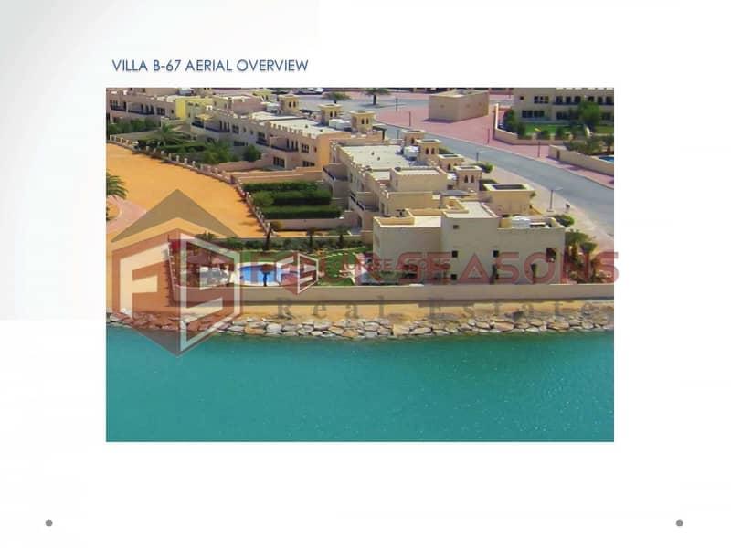 2 4BR + maids  villa golf course & lagoon view.