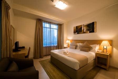 شقة فندقية 1 غرفة نوم للايجار في أبراج بحيرات جميرا، دبي - An Effortless Stay w/ Stunning Lake View