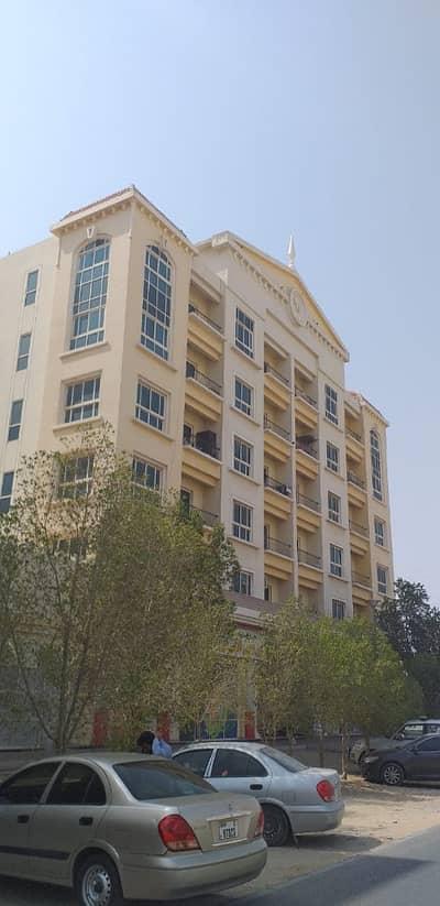 شقة 2 غرفة نوم للايجار في المدينة العالمية، دبي - Building View