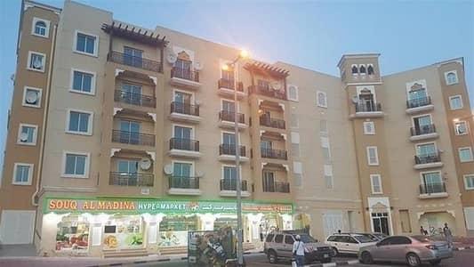 فلیٹ 1 غرفة نوم للايجار في المدينة العالمية، دبي - LIMITED OFFER - FAMILY AREA 1BHK WITH BALCONY IN EMIRATES CLUSTER
