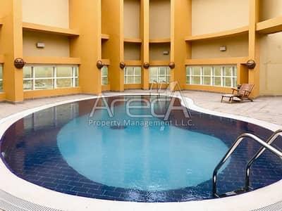 1 Bedroom Flat for Sale in Danet Abu Dhabi, Abu Dhabi - Hot Deal 1 Bed Apt! Ear Huge ROI on A Freehold Property inside Abu Dhabi