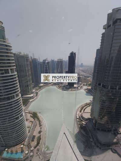مکتب  للبيع في أبراج بحيرات جميرا، دبي - FURNISHED OFFICE WITH LAKE VIEW IN ALMAS TOWER I HIGH FLOOR