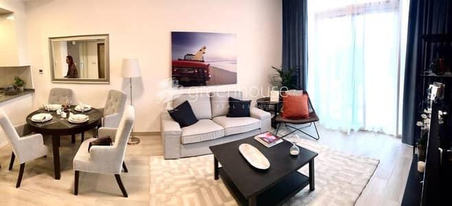 استوديو  للبيع في قرية جميرا الدائرية، دبي - Modern Eco-Friendly Apartment with Pool View