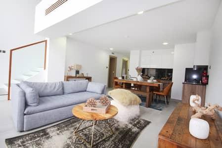 1 Bedroom Flat for Sale in Jumeirah Village Circle (JVC), Dubai - living