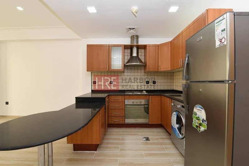 9 Upgraded 1BR Apartment in Silicon Oasis