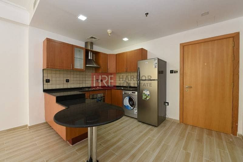 10 Upgraded 1BR Apartment in Silicon Oasis