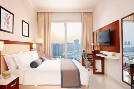 Studio for Rent in Dubai Sports City, Dubai - Deluxe Studio Apartments |Balcony -Monthly