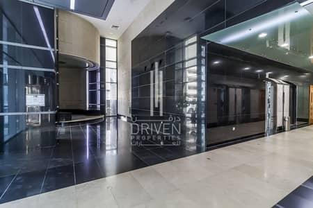 فلیٹ 1 غرفة نوم للايجار في الخليج التجاري، دبي - Chiller free and Equipped kitchen in 4cheques