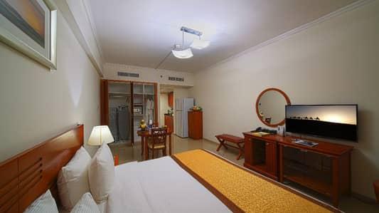 شقة فندقية  للايجار في بر دبي، دبي - Master Bedroom