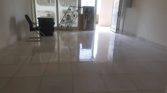 Shop for Rent in International City, Dubai - England cluster , retail shop front road side facing with 4 cheques