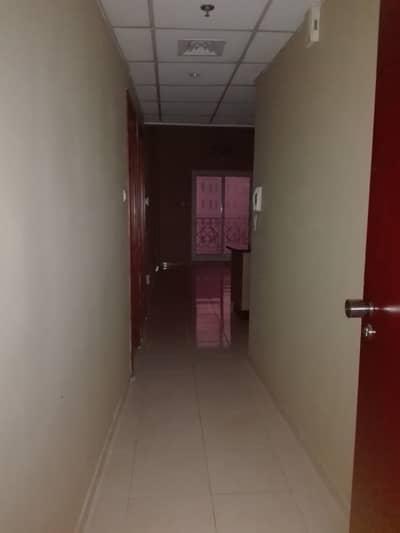 شقة 1 غرفة نوم للايجار في المدينة العالمية، دبي - شقة في منطقة مركز الأعمال المدينة العالمية 1 غرف 32000 درهم - 4225818