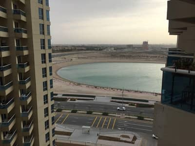 Studio for Sale in Dubai Production City (IMPZ), Dubai - HOT DEAL IPMZ Crescent Tower B Semi furnished Studio with Parking Lake View Price 298k/-net