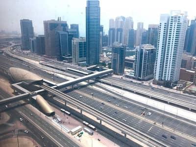 مکتب  للبيع في أبراج بحيرات جميرا، دبي - High floor office in Saba 1 - Investor deal