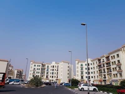 فلیٹ 1 غرفة نوم للايجار في المدينة العالمية، دبي - شقة في طراز اليونان المدينة العالمية 1 غرف 29000 درهم - 4238793