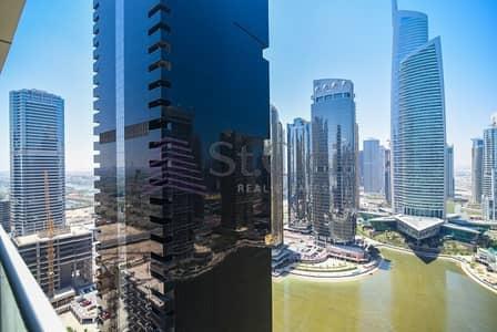 استوديو  للايجار في أبراج بحيرات جميرا، دبي - Studio in Dubai Arch | High Floor | Community View