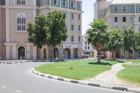 محل تجاري  للبيع في المدينة العالمية، دبي - محل تجاري في طراز فرنسا المدينة العالمية 400000 درهم - 4245543