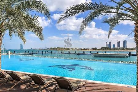 1 Bedroom Apartment for Sale in Palm Jumeirah, Dubai - 0% Commission Beachfront 1BR Apartment