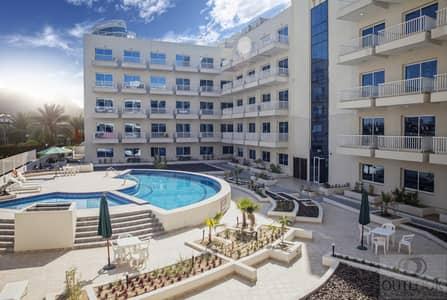 1 Bedroom Flat for Sale in Jumeirah Village Circle (JVC), Dubai - Urgent Sale | Furnished 1 BR | Near Park