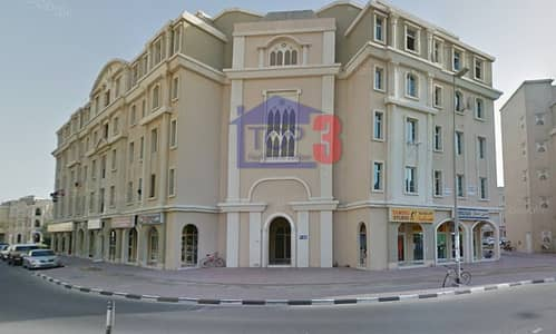 Studio for Rent in International City, Dubai - un-furnished Studio with balcony for rent in France Cluster Monthly 2500