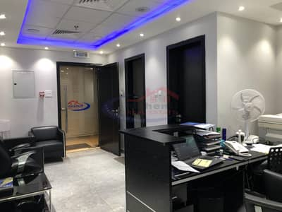 Office for Sale in Jumeirah Village Circle (JVC), Dubai - fully glass fitted office with partitions