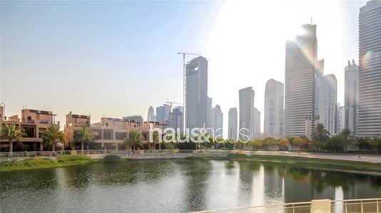فلیٹ 3 غرفة نوم للبيع في تلال الجميرا، دبي - 3 Bedroom Duplex Lake Facing Vacant on Transfer
