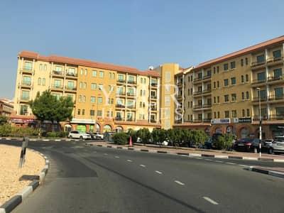 محل تجاري  للايجار في المدينة العالمية، دبي - Shop 4 Rent in Spain cluster 36k low price